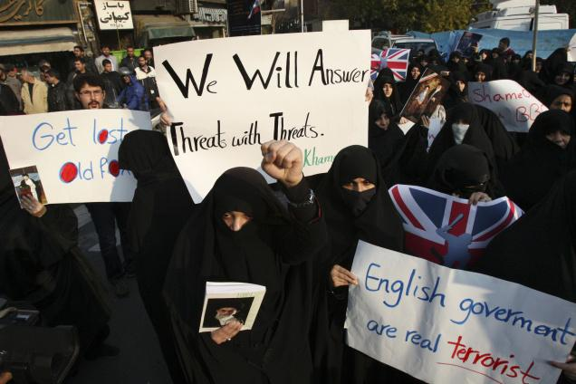 Iranian protesters during a demonstration in front of the British Embassy, in Tehran, on Tuesday 29 November.