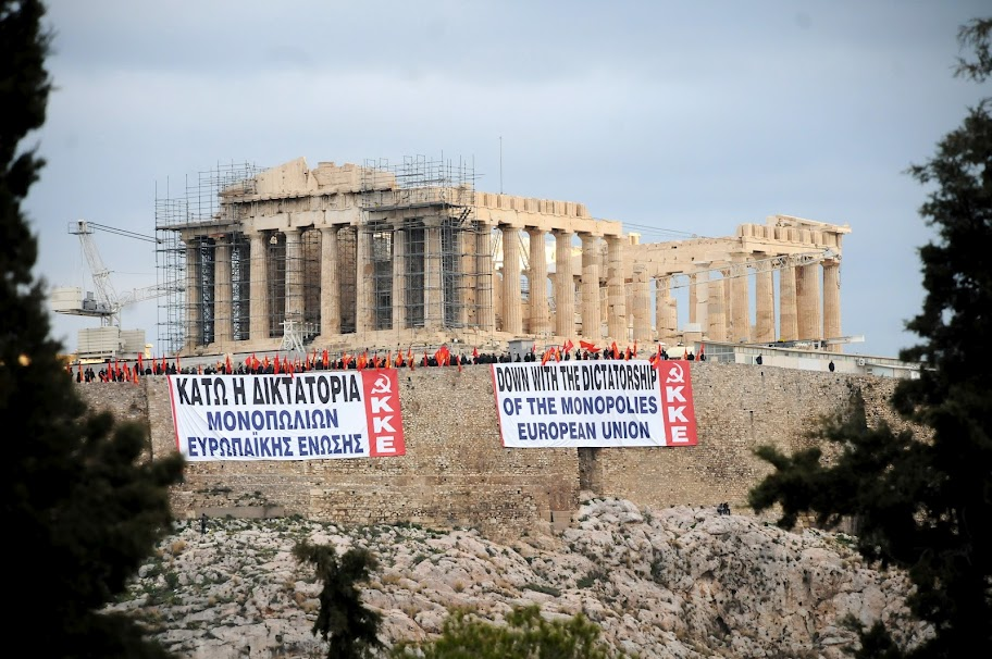 Communists unfurl their banners from the Acropolis in Athens on Saturday 11 February 2012, day two of a general strike