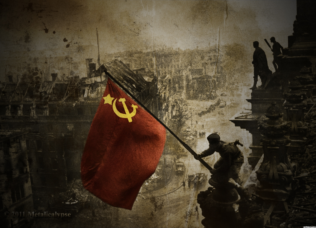 The true spirit of '45: A Soviet soldier hoists the red flag over the Reichstag in Berlin, marking the complete defeat of Nazi fascism.
